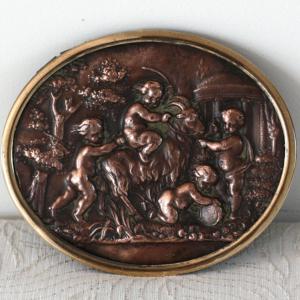 Ancien médaillon en cuivre
